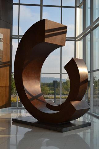 Image of large bronze, stanless steel and glass sculpture.