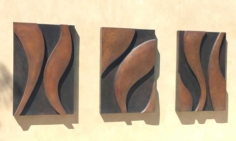 Image of a 3 panel bronze wall sculpture.