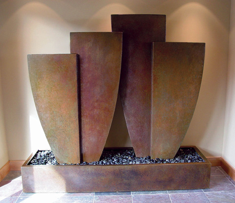 Image of a large bronze water feature.