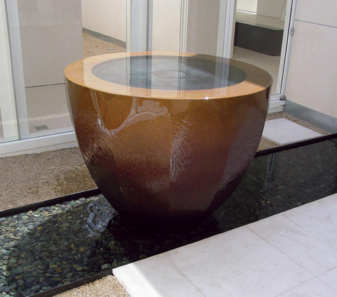 Image of a bronze water feature.
