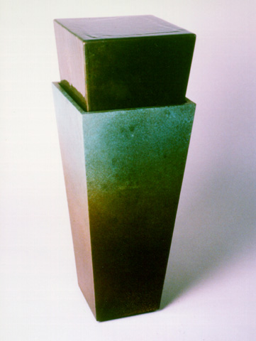 Image of a small bronze water feature.