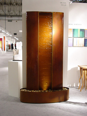 Image of a bronze and glass waterwall.